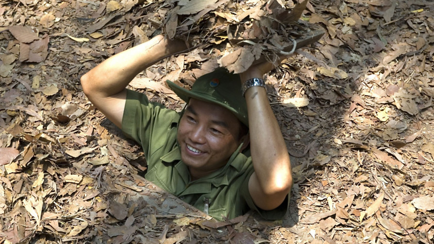 See the Cu Chi tunnels in Vietnam