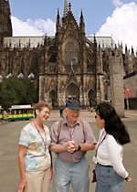 View a few passengers enjoying their time in Cologne Germany