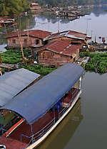 Explore Uthaithani on a rice barge cruise