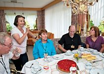View some passengers enjoying a home-hosted dinner in a village near Wertheim