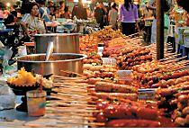 Explore a street market in Bangkok