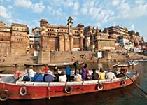 See temples at sunrise on a Ganges River boat cruise
