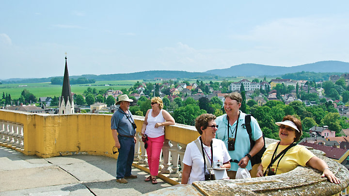 View a few travelers enjoying their time in Melk Austria